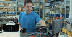 Technician testing LED fixture in a production facility Stock Footage