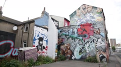 Graffiti-covered yard in Brighton Stock Footage