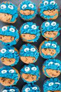 Blue icing Cookie monster cupcakes - stock photo