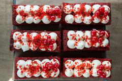 Red Velvet Cakes with icing and redcurrants on top Stock Photos