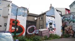 Gigantic Graffiti: yard in Brighton - stock footage