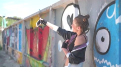 a sexy girl doing selfie on graffiti wall - stock footage