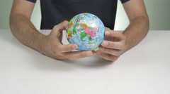 4K Earth Planet Holding in Hands Stock Footage