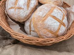 Fresh hearth bread in basket Stock Photos
