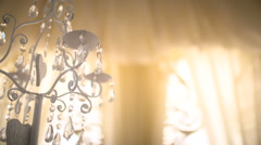 Candle on a crystal candlestick Stock Footage