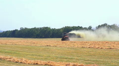 Red tractor working at the field. Stock Footage