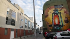 Creative wall art graffiti of an oil lamp pan Stock Footage