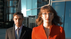 Two serious business people go Stock Footage