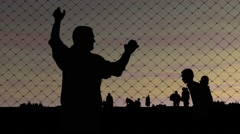 Refugees. Men and women and a fence. The concept of refugees Stock Footage