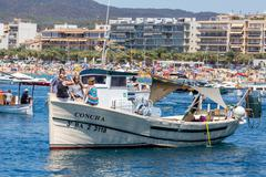 Nautical procession of the Virgen del Carmen (saint of sailors) - stock photo