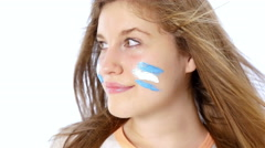 Girl with Argentinian flag on her face smiling Stock Footage
