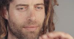 Close up of a man with a beard smoking - stock footage