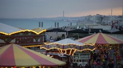 Carousels and amusements on Brighton Beach in England Stock Footage