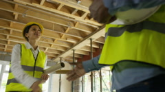 4K Male & female members of construction team meet on site & shake hands Stock Footage