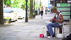 Street musician playing guitar chapel street  Stock Footage