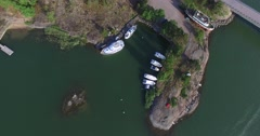 Cinema 4k aerial view on boats at a bay in barosund, in Inkoo archipelago, Fi Stock Footage