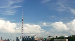 Time Lapse Television Tower against blue sky, curling cumulus clouds fast move Stock Footage