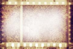 Film negative frames on grunge background Stock Illustration