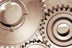 Metal cog gears joining together Kuvituskuvat
