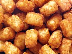 Rustic golden potato tater tots food background Stock Photos