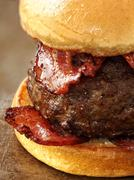 Rustic carnivore meat lover hamburger Stock Photos