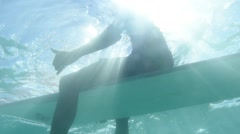 Backlit Surfer (Underwater) Stock Footage