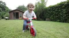 Toddler riding his pushbike Stock Footage