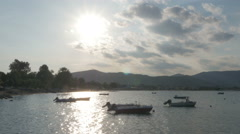 Sunset in bay with boats and town under mountain in dusk, seascape by Sheyno. Stock Footage