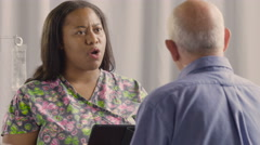 Nurse giving instructions to senior male patient Stock Footage