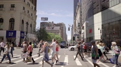 customers crossing street in shopping stores area in new york city - stock footage