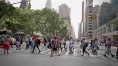 Camera moving through people that crossing street in the city Stock Footage