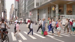 Large crowd of people crossing street in new york city Stock Footage