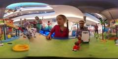 360Vr Video Kid Playing a Toy Ambulance Car Playroom Shopping Center Sysadmin Stock Footage