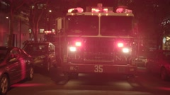 Fire department trucks getting emergency call. fireman rescue scene at night Stock Footage