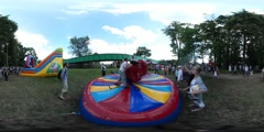 360Vr Video Kids Riding on Inflatable Bull Amusement Parents on Playground Mom Stock Footage