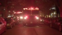 Fire department trucks getting emergency call. flashing siren light at night Stock Footage