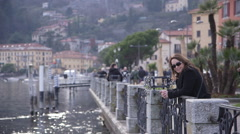 Tourist looking out over lake como - stock footage