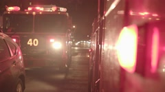 two Fire department trucks getting emergency call. fireman rescue scene at night - stock footage