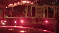 Fire department trucks getting emergency call. fireman rescue scene at night - stock footage