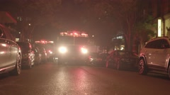 Emergency scene of Fire department trucks in the city streets at night Stock Footage