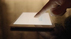 Reviewing business profits statistics on digital tablet computer screen Stock Footage