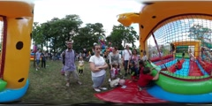 360Vr Video Kids Jumping on Inflatable Amusement in Park Opole Family Picnic Stock Footage