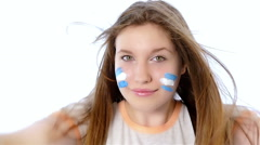 Girl waving Argentinian flag and smiling, slow motion Stock Footage