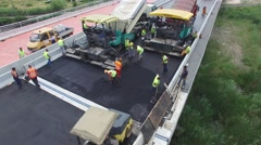 Aerial view on workers with heavy machines working on bridge reconstruction Stock Footage