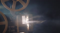 Old film projector is working in a smoke. Close up Stock Footage