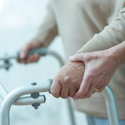 Walking with assistance - stock photo