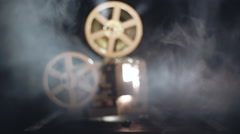 Old antique film projector is working in a smoke Stock Footage