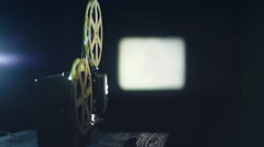Old movie projector showing film Stock Footage