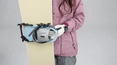 Young attractive Japanese woman with snowboard against grey background Stock Footage
