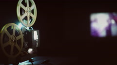 Old movie projector showing film. Footage by slider camera Stock Footage